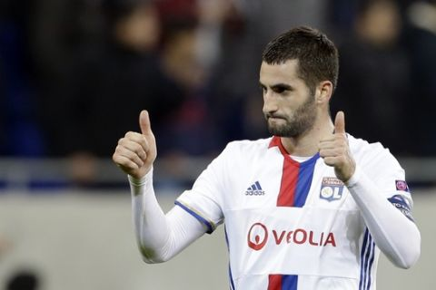 Lyon's Maxime Gonalons cheers to supporters after his team's victory at the end of his Europa League round of 16 first leg soccer match against Roma in Decines, near Lyon, central France, Thursday, March 9, 2017. (AP Photo/Claude Paris)