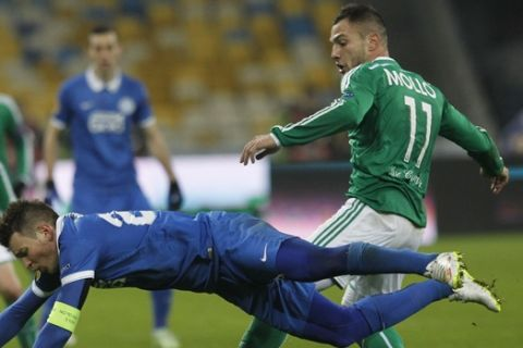Saint-Etienne Yohan Mollo, right, challenges for the ball against Ruslan Rotan of Dnipro Dnipropetrovsk during a Europa League Group F soccer match between Dnipro Dnipropetrovsk and Saint-Etienne at the Olympiyskiy national stadium in  Kiev, Ukraine, Thursday, Dec. 11, 2014.  (AP Photo/Sergei Chuzavkov)