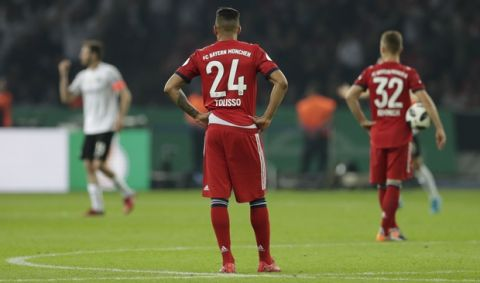 Bayern's Corentin Tolisso reacts after Frankfurt's Ante Rebic scored his side's second goal during the German soccer cup final match between FC Bayern Munich and Eintracht Frankfurt in Berlin, Germany, Saturday, May 19, 2018. (AP Photo/Michael Sohn)