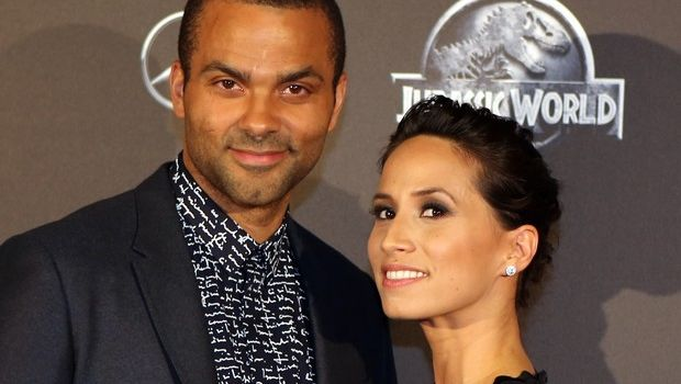 NBA San Antonio Spurs player, Tony Parker of France poses with his friend Axelle Francine, as he arrives at the French premiere of U.S. movie Jurassic World in Paris, Friday May 29, 2015. (AP Photo/Remy de la Mauviniere)