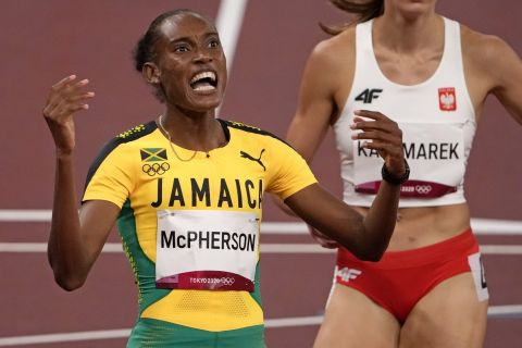 Stephenie Mcpherson, of Jamaica reacts after winning a women's 400-meter semifinal at the 2020 Summer Olympics, Wednesday, Aug. 4, 2021, in Tokyo, Japan. (AP Photo/Charlie Riedel)