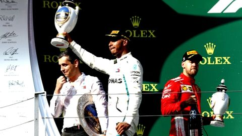 Race winner Mercedes driver Lewis Hamilton of Britain and second placed Ferrari driver Sebastian Vettel of Germany, right, hold their trophies on the podium of the Hungarian Formula One Grand Prix, at the Hungaroring racetrack in Mogyorod, northeast of Budapest, Sunday, July 29, 2018. (AP Photo/Laszlo Balogh)