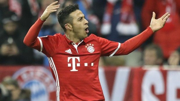 Bayern's Thiago Alcantara celebrates after scoring his side's fourth goal during the Champions League round of 16 first leg soccer match between FC Bayern Munich and Arsenal, in Munich, Germany, Wednesday, Feb. 15, 2017. (AP Photo/Matthias Schrader)