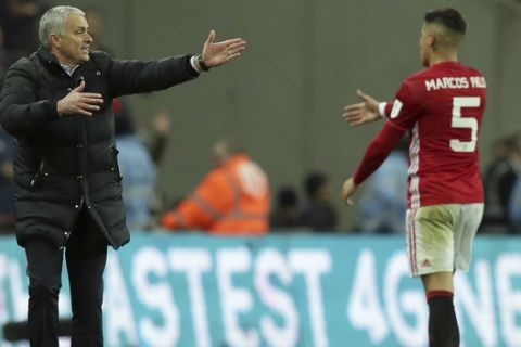 Manchester United's manager Jose Mourinho, left, gestures towards Manchester United's Marcos Rojo during the English League Cup final soccer match between Manchester United and Southampton FC at Wembley stadium in London, Sunday, Feb. 26, 2017. (AP Photo/Tim Ireland)