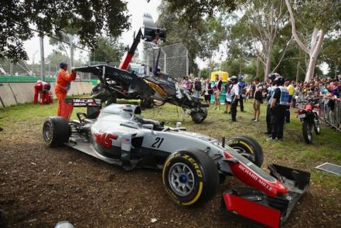 MELBOURNE, AUSTRALIA - MARCH 20: The car of Romain Grosjean of France drives the (8) Haas F1 Team Haas-Ferrari VF-16 Ferrari 059/5 turbo at the side of the track after a crash with Fernando Alonso of Spain and McLaren Honda during the Australian Formula One Grand Prix at Albert Park on March 20, 2016 in Melbourne, Australia.  (Photo by Robert Cianflone/Getty Images)