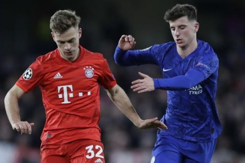 Bayern's Joshua Kimmich, left, is challenged by Chelsea's Mason Mount during a first leg, round of 16, Champions League soccer match between Chelsea and Bayern Munich at Stamford Bridge stadium in London, England, Tuesday Feb. 25, 2020. (AP Photo/Kirsty Wigglesworth)
