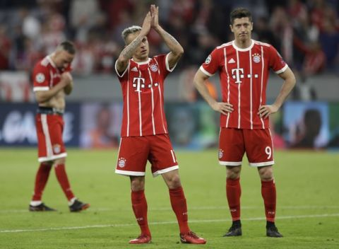 Bayern's Franck Ribery, Rafinha and Robert Lewandowski, from left, look disappointed after losing 1-2 during the semifinal first leg soccer match between FC Bayern Munich and Real Madrid at the Allianz Arena stadium in Munich, Germany, Wednesday, April 25, 2018. (AP Photo/Matthias Schrader)