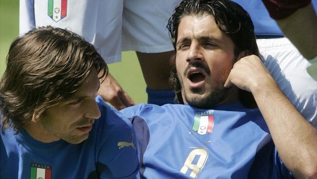 Italy's soccer team midfielder Gennaro Gattuso, right, and Andrea Pirlo relax as they pose for the official photo wearing the new jerseys designed by Dolce & Gabbana, prior to a practice session at the Coverciano training grounds, near Florence, Italy, Thursday May 25, 2006 in view of the forthcoming World Cup 2006 in Germany. Italy will play in Group E with USA, Czech Republic and Ghana. (AP Photo/Lorenzo Galassi)