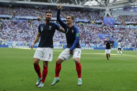France's Antoine Griezmann, right, celebrates after scoring the penalty opening goal with France's Olivier Giroud, left, during the round of 16 match between France and Argentina, at the 2018 soccer World Cup at the Kazan Arena in Kazan, Russia, Thursday, June 28, 2018. (AP Photo/Ricardo Mazalan)