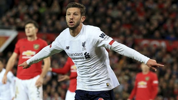 Liverpool's Adam Lallana, center, celebrates after scoring his side's opening goall during the English Premier League soccer match between Manchester United and Liverpool at the Old Trafford stadium in Manchester, England, Sunday, Oct. 20, 2019. (AP Photo/Jon Super)