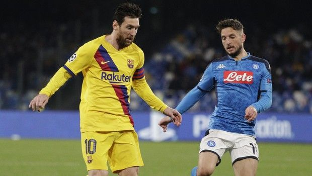 Barcelona's Lionel Messi, left, and Napoli's Dries Mertens challenge for the ball during the Champions League, Round of 16, first-leg soccer match between Napoli and Barcelona, at the San Paolo Stadium in Naples, Italy, Tuesday, Feb. 25, 2020. (AP Photo/Andrew Medichini)