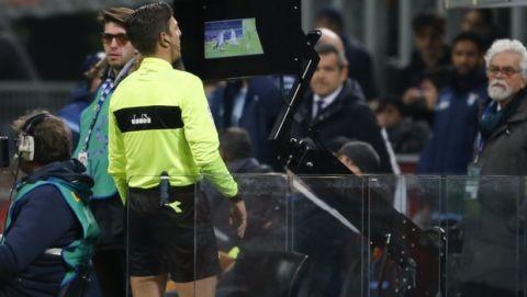 Referee Gianluca Rocchi checks the VAR during the Serie A soccer match between Inter Milan and Lazio, at the Milan's San Siro stadium, Italy, Saturday, Dec. 30, 2017. (AP Photo/Antonio Calanni)