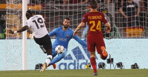 Liverpool's Sadio Mane, left, kicks the ball to score past Roma's Alessandro Florenzi, right, and goalkeeper Alisson, during the Champions League semifinal second leg soccer match between Roma and Liverpool at the Olympic Stadium in Rome, Wednesday, May 2, 2018. (AP Photo/Riccardo De Luca)