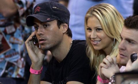 Enrique Iglesias, left, and his wife Anna Kournikova, second from left, watch the game between the Miami Heat and the Cleveland Cavaliers of a basketball game in Miami, Thursday, Feb. 1, 2007. The Heat won, 92-89. (AP Photo/Alan Diaz)