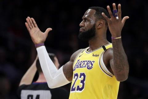 Los Angeles Lakers' LeBron James reacts after making a 3-point basket against the New Orleans Pelicans during the first half of an NBA basketball game Tuesday, Feb. 25, 2020, in Los Angeles. (AP Photo/Marcio Jose Sanchez)