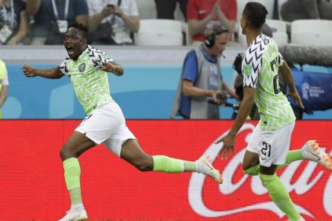 Nigeria's Ahmed Musa, left, celebrates after scoring his side's first goal during the group D match between Nigeria and Iceland at the 2018 soccer World Cup in the Volgograd Arena in Volgograd, Russia, Friday, June 22, 2018. (AP Photo/Andrew Medichini)