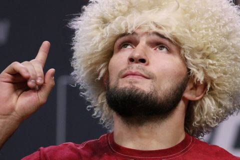 Khabib Nurmagomedov poses during a ceremonial weigh-in for the UFC 229 mixed martial arts fight Friday, Oct. 5, 2018, in Las Vegas. Nurmagomedov is scheduled to fight Conor McGregor Saturday in Las Vegas. (AP Photo/John Locher)