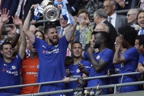 Chelsea's Olivier Giroud lifts the trophy after winning the English FA Cup final soccer match between Chelsea and Manchester United at Wembley stadium in London, Saturday, May 19, 2018. Chelsea defeated Manchester United 1-0. (AP Photo/Tim Ireland)