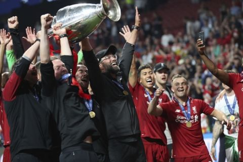 Liverpool's coach Juergen Klopp, center, celebrate with his teammates after winning the Champions League final soccer match between Tottenham Hotspur and Liverpool at the Wanda Metropolitano Stadium in Madrid, Saturday, June 1, 2019. (AP Photo/Francisco Seco)