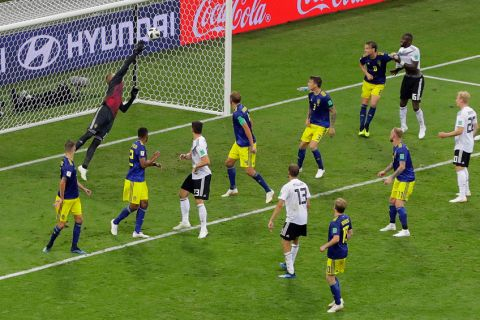 Sweden goalkeeper Robin Olsen, fails to save goal from Germany's Toni Kroos, during the group F match between Germany and Sweden at the 2018 soccer World Cup in the Fisht Stadium in Sochi, Russia, Saturday, June 23, 2018. (AP Photo/Sergei Grits)