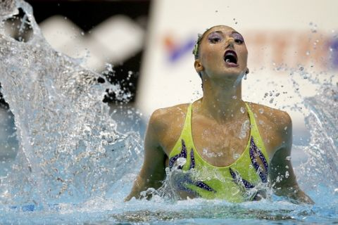 Evangelia Platanioti from Greece performs during the solo synchronized swimming free routine at the LEN Swimming European Championships in Berlin, Germany, Friday, Aug. 15, 2014. (AP Photo/Michael Sohn)