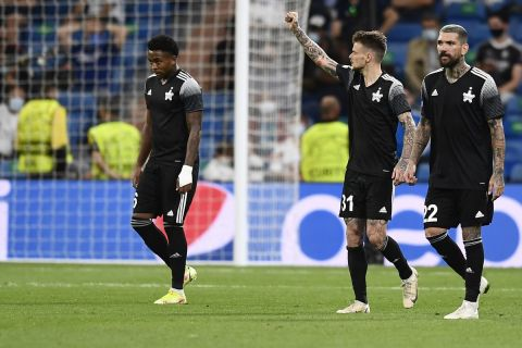 Sheriff's Sebastien Thill, center, celebrates after scoring his side's second goal during the Champions League group D soccer match between Real Madrid and Sheriff, Tiraspol at the Bernabeu stadium in Madrid, Spain, Tuesday, Sept. 28, 2021. (AP Photo/Jose Breton)