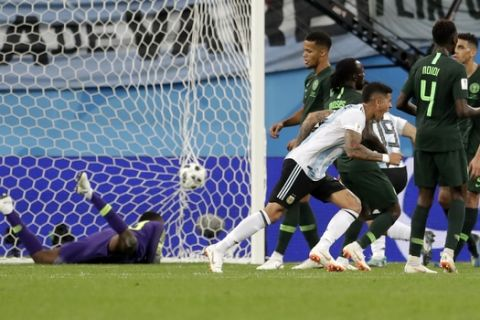 Argentina's Marcos Rojo, scores his side's second goal during the group D match between Argentina and Nigeria, at the 2018 soccer World Cup in the St. Petersburg Stadium in St. Petersburg, Russia, Tuesday, June 26, 2018. Argentina won 2-1. (AP Photo/Petr David Josek)