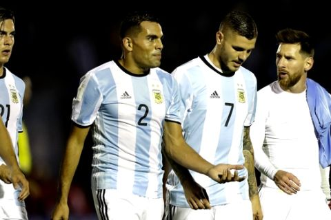 Carrying on his shoulder Luis Suarez's shirt, Argentina's Lionel Messi, right, talks to Argentina's Mauro Icardi after the first half of a 2018 World Cup qualifying soccer match against Uruguay in Montevideo, Uruguay, Thursday, Aug. 31, 2017.(AP Photo/Natacha Pisarenko)