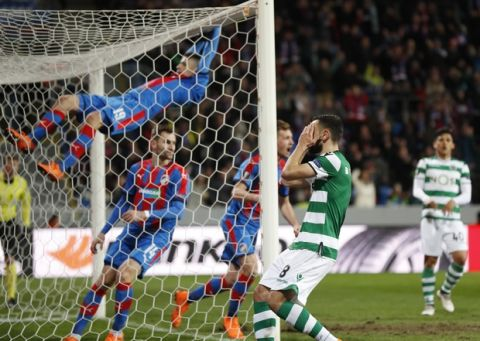 Sporting's Bruno Fernandes covers his faces after missing a chance during the Europa League round of 16 second leg soccer match between Sporting CP and FC Viktoria Plzen in Plzen, Czech Republic, Thursday, March 15, 2018. (AP Photo/Petr David Josek)