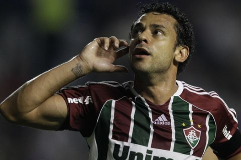 Brazil's Fluminense's Fred celebrates after scoring during a Copa Libertadores soccer match against Argentina's Boca Juniors in Buenos Aires, Argentina, Wednesday, March 7, 2012. (AP Photo/Natacha Pisarenko)