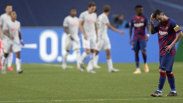 Barcelona's Lionel Messi, right, holds his head after Bayern's Ivan Perisic scored his teams second goal during the Champions League quarterfinal match between FC Barcelona and Bayern Munich at the Luz stadium in Lisbon, Portugal, Friday, Aug. 14, 2020. (AP Photo/Manu Fernandez/Pool)