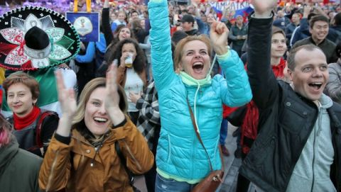Fans celebrate after Russia's fourth goal during the opening match of the 2018 soccer World Cup, between Russia and Saudi Arabia, in the fan zone in Yekaterinburg, Russia, Thursday, June 14, 2018. (AP Photo/Vadim Ghirda)