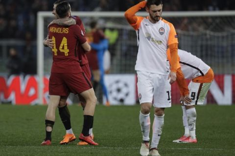 Roma's Kostas Manolas and Aleksandar Kolarov celebrate their side's 1-0 win at the end of a Champions League round of 16 second-leg soccer match between Roma and Shakhtar Donetsk, at the Rome Olympic stadium, Tuesday, March 13, 2018. (AP Photo/Gregorio Borgia)