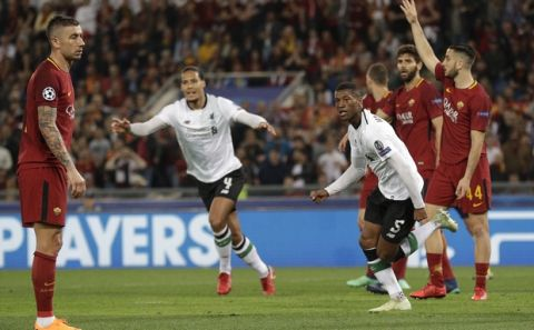 Liverpool's Georginio Wijnaldum, right, celebrates after he scores his side's second goal during the Champions League semifinal second leg soccer match between Roma and Liverpool at the Olympic Stadium in Rome, Wednesday, May 2, 2018. (AP Photo/Andrew Medichini)
