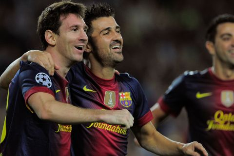 Barcelona's Argentinian forward Lionel Messi (L) is congratuled by his teammate Barcelona's forward David Villa (R) after scoring during the UEFA Champions League football match FC Barcelona against FC Spartak Moscou  at the Camp Nou stadium in Barcelona on September 19, 2012. AFP PHOTO/ JOSEP LAGO        (Photo credit should read JOSEP LAGO/AFP/GettyImages)