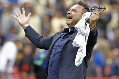 Monterrey's coach Antonio Mohamed celebrates after his team defeated America 4-2 in a penalty shootout to win the Mexican soccer league final match at Azteca stadium in Mexico City, Sunday, Dec. 29, 2019. (AP Photo/Ginnette Riquelme)