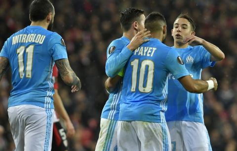 Teammates congratulate Marseille's Dimitri Payet after Payet scored his side opening goal during their Europa League round of 16, 2nd leg, match between Athletic Bilbao and Olympique Marseille, at San Mames stadium, in Bilbao, northern Spain, Thursday, March 15, 2018. (AP Photo/Alvaro Barrientos)