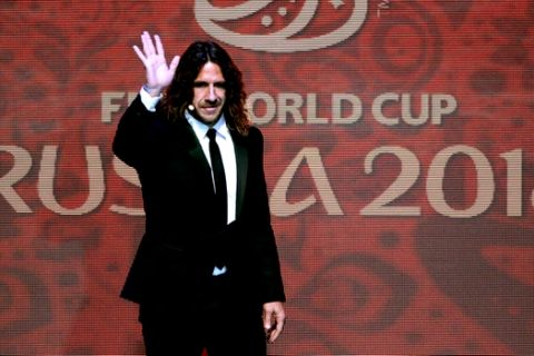 Former Spanish soccer international Carles Puyol arrives at the 2018 soccer World Cup draw in the Kremlin in Moscow, Friday, Dec. 1, 2017. (AP Photo/Ivan Sekretarev)