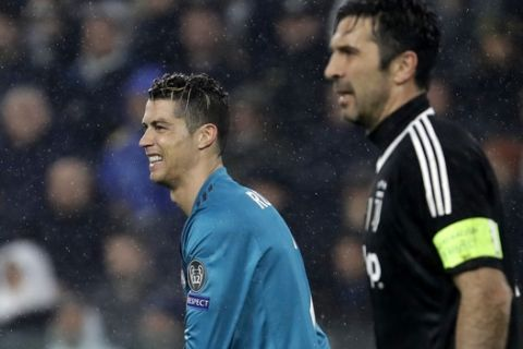 Real Madrid's Cristiano Ronaldo, left, reacts next to Juventus goalkeeper Gianluigi Buffon during the Champions League, round of 8, first-leg soccer match between Juventus and Real Madrid at the Allianz stadium in Turin, Italy, Tuesday, April 3, 2018. (AP Photo/Luca Bruno)
