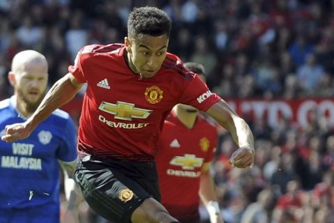 Manchester United's Jesse Lingard kicks the ball during the English Premier League soccer match between Manchester United and Cardiff City at Old Trafford in Manchester, England, Sunday, May 12, 2019. (AP Photo/Rui Vieira)