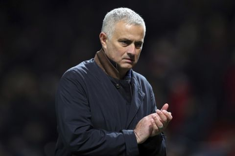 ManU coach Jose Mourinho applauds at the end of the Champions League group H soccer match between Manchester United and Young Boys at Old Trafford Stadium in Manchester, England, Tuesday Nov. 27, 2018. (AP Photo/Jon Super)