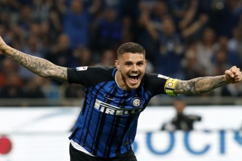 Inter Milan's Mauro Icardi celebrates after Juventus' Andrea Barzagli scoring own goal past his goalkeeper during the Serie A soccer match between Inter Milan and Juventus at the San Siro stadium in Milan, Italy, Saturday, April 28, 2018. (AP Photo/Antonio Calanni)