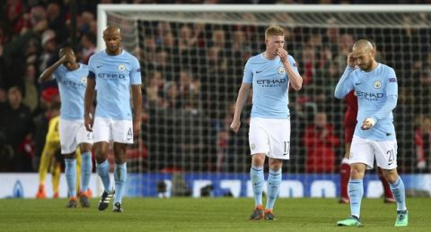 Manchester City players walk away from the goal after Liverpool's Sadio Mane scored Liverpool's third goal during the Champions League quarter final first leg soccer match between Liverpool and Manchester City at Anfield stadium in Liverpool, England, Wednesday, April 4, 2018. (AP Photo/Dave Thompson)