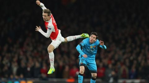 LONDON, ENGLAND - FEBRUARY 23:  Lionel Messi of Barcelona and Nacho Monreal of Arsenal battle for posession during the UEFA Champions League round of 16 first leg match between Arsenal and Barcelona on February 23, 2016 in London, United Kingdom.  (Photo by Paul Gilham/Getty Images)