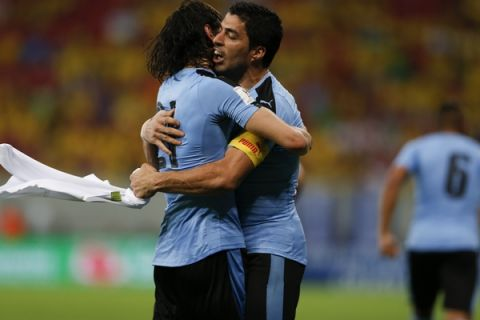 Uruguay's Luis Suarez, right, celebrates with teammate Edinson Cavani after scoring against Brazil during a 2018 World Cup qualifying soccer match at the Pernambuco Arena, in Recife, Brazil, Friday, March 25, 2016. (AP Photo/Leo Correa)