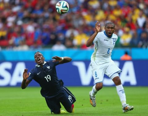 PORTO ALEGRE, BRAZIL - JUNE 15:  Wilson Palacios of Honduras fouls Paul Pogba of France resulting in a penalty kick during the 2014 FIFA World Cup Brazil Group E match between France and Honduras at Estadio Beira-Rio on June 15, 2014 in Porto Alegre, Brazil.  (Photo by Jeff Gross/Getty Images)