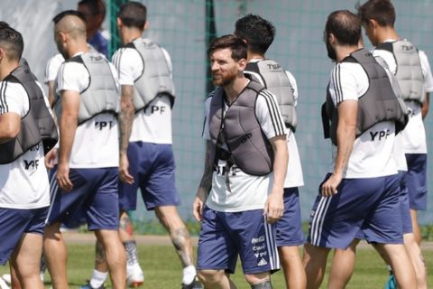 Lionel Messi and teammates work with weight vests during a training session of Argentina at the 2018 soccer World Cup in Bronnitsy, Russia, Saturday, June 23, 2018. (AP Photo/Ricardo Mazalan)