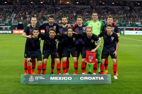 FILE - In this photo taken on Tuesday, March 27, 2018, the starters for Croatia pose for a photo before an international friendly soccer match against Mexico in Arlington, Texas. (AP Photo/Roger Steinman)