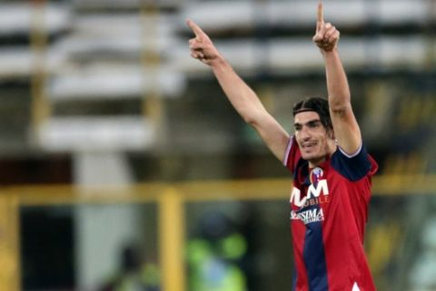 Bologna's Lazaros Christodoulopoulos, of Greece, celebrates after scoring the winning goal during an Italian Serie A soccer match between Bologna and Fiorentina at Renato Dall' Ara stadium in Bologna, Italy, Tuesday, Feb. 26, 2013. (AP Photo/Gianfilippo Oggioni)