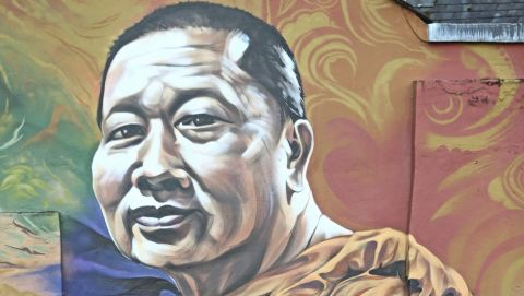 A mural of Leicester City's owner, Thai billionaire Vichai Srivaddhanaprabha near the Leicester City Football Club after a helicopter crashed in flames the day before, in Leicester, England, Sunday, Oct. 28, 2018. A helicopter belonging to Leicester City's owner, Thai billionaire Vichai Srivaddhanaprabha, crashed in flames in a car park next to the soccer club's stadium shortly after it took off from the field following a Premier League game on Saturday night. (Aaron Chown/PA via AP)